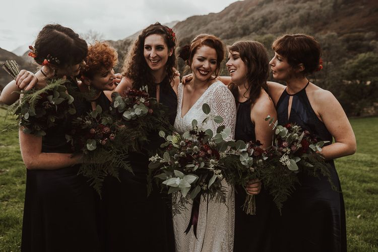 Navy Bridesmaid dresses with foliage bouquets