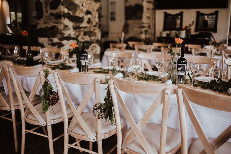 Wedding table decor with simple wedding flowers and foliage