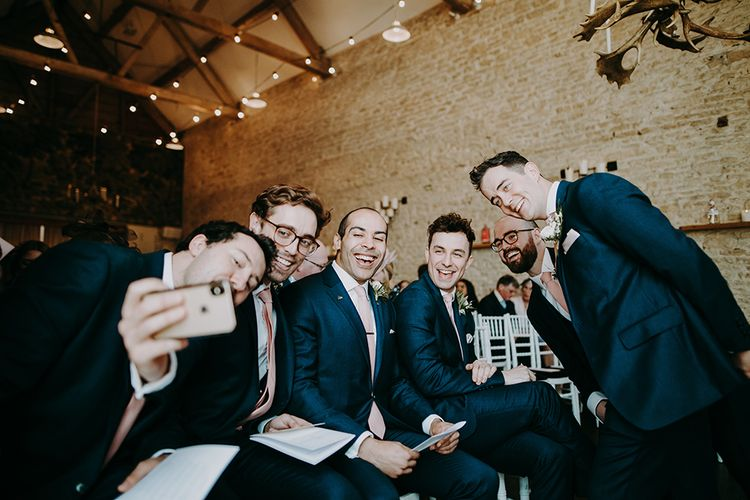 Groomsmen at the Altar in Navy Moss Bros. Suits Taking a Selfie