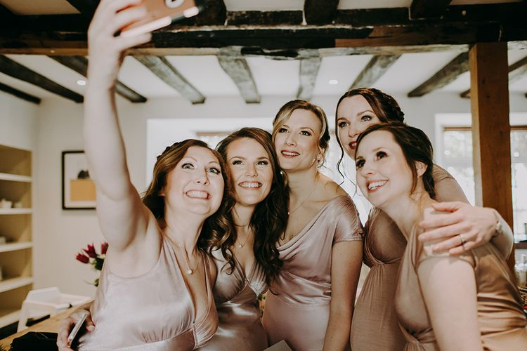 Bridesmaids in Pale Pink Ghost Dresses Taking a Selfie