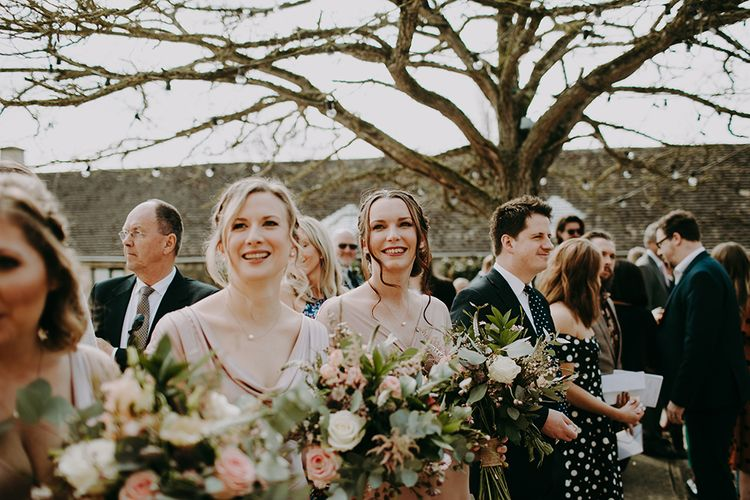 Bridesmaids in Pink Ghost Dresses Holding Romantic Bouquets