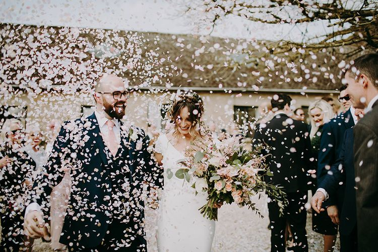 Confetti Exit with Bride in Pronovias Dralan Wedding Dress  and Groom in Navy Blue Moss Bros.  Suit