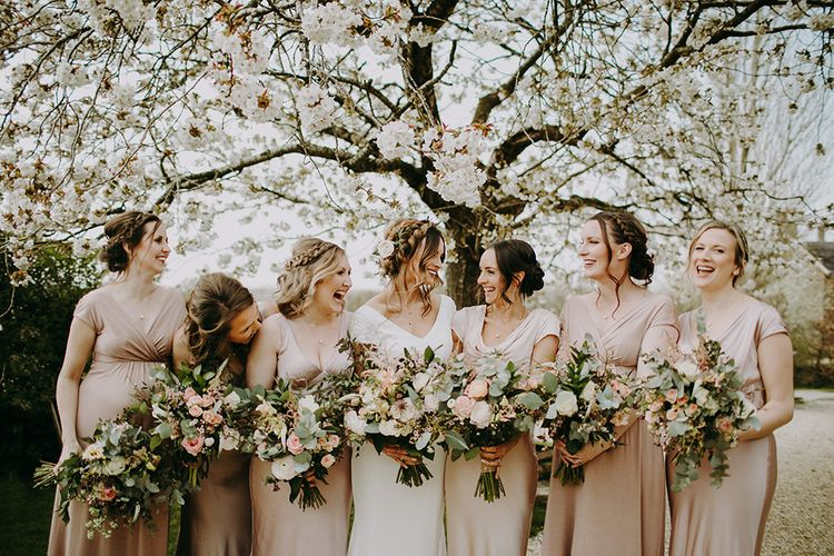 Bridal Party Portrait with Bridesmaids in Pink Ghost Dresses and Bride in Pronovias Dralan Wedding Dress