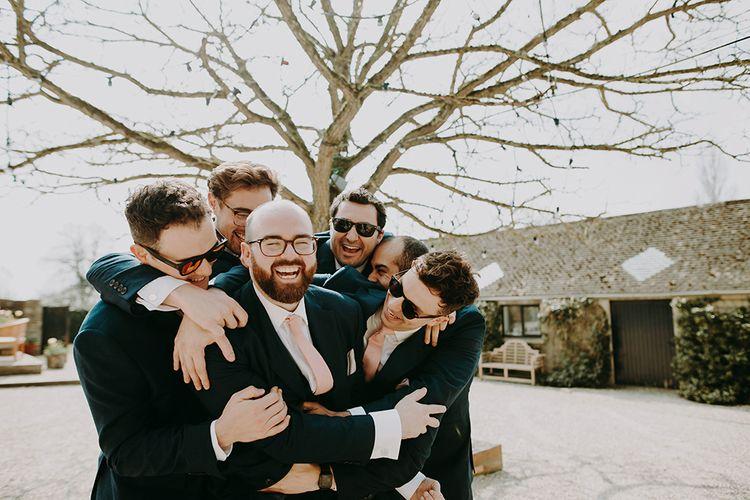Groomsmen in Moss Bros. Suits with Pink Ties