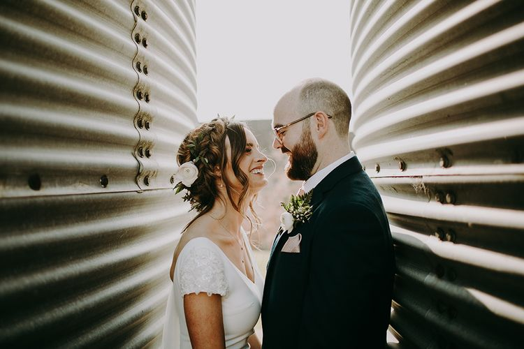 Bride in Pronovias Dralan Wedding Dress and Groom in Navy Moss Bros. Suit Smiling