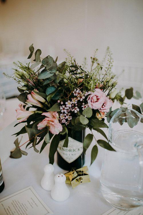 Wedding Flowers in Gin Bottles