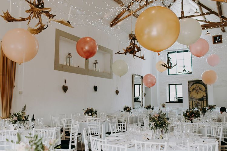 Merriscourt Barn Wedding Venue Decorated with Giant Balloons and Fairy Lights