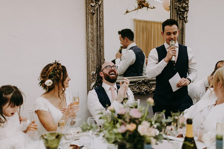 Bride and Groom Laughing During Best Mans Wedding Speech