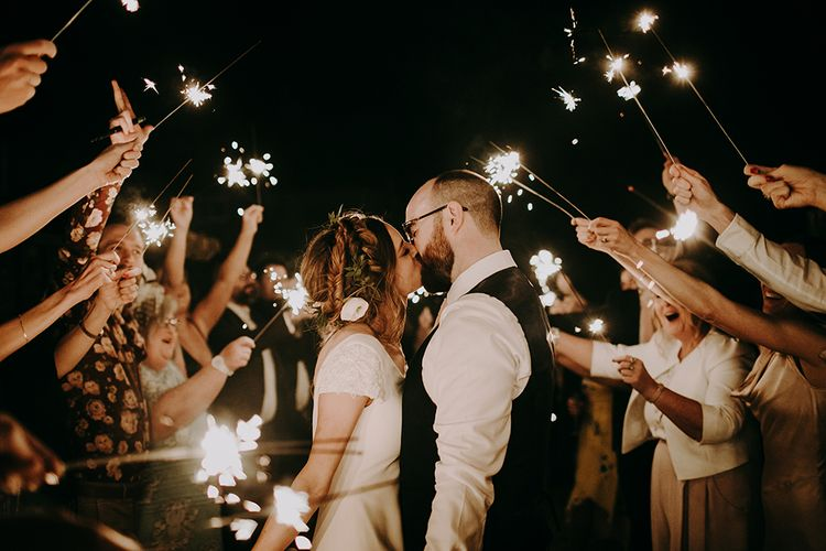 Sparkler Moment with Bride in Pronovias Dralan Wedding Dress and Groom in Moss Bros. Suit