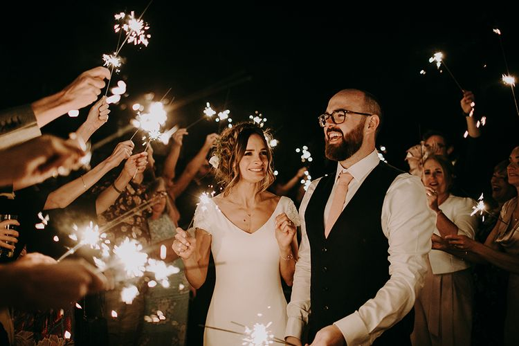 Sparkler Exit with Bride in Pronovias Dralan Wedding Dress and Groom in Moss Bros. Suit