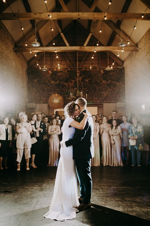 First Dance with Bride in Pronovias Dralan Wedding Dress and Groom in Moss Bros. Suit