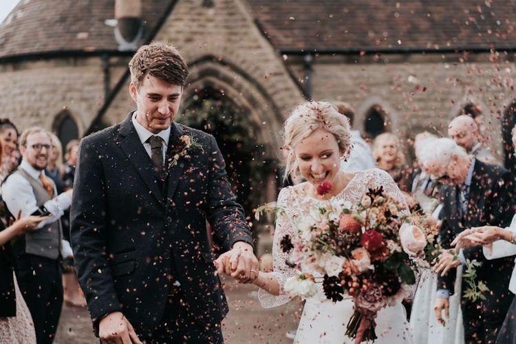 Bride and Groom Wedding Ceremony Confetti Shot