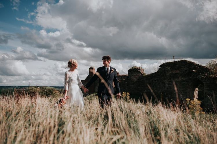 Bride in Beautiful Two Piece Gown and Groom in Three Piece Suit