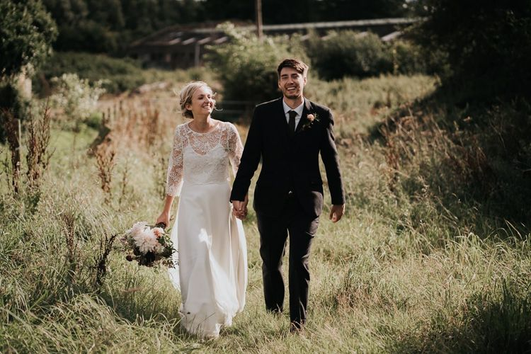 Bride in Handmade Two Piece Gown and Groom in Three Piece Suit