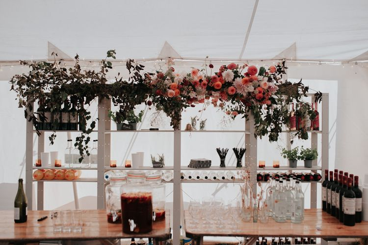 Blush and Pink Flower Arrangement for Wedding Reception Bar with Chalkboard Wedding Signs
