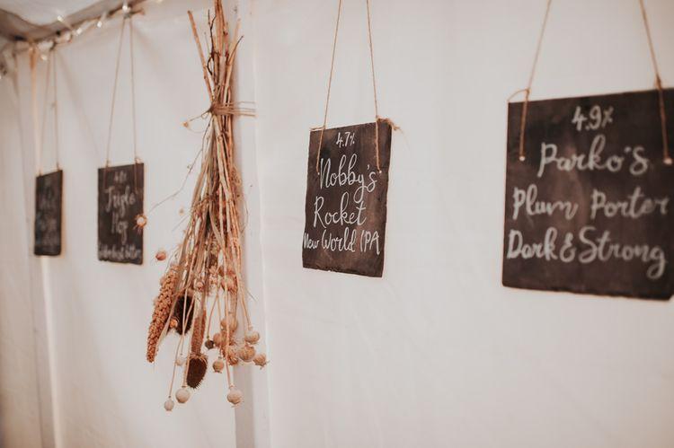 Chalkboard Wedding Signs at Late Summer Marquee Wedding