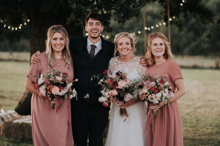 Bridesmaids in Blush Dresses with Pom Pom Dahlia and Cosmos Bouquets