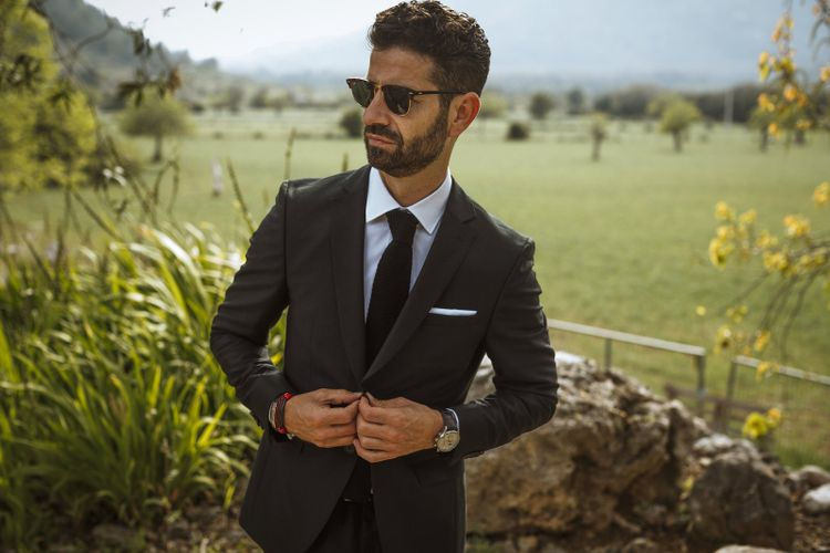 Stylish Groom in Hugo Boss Suit and Shades