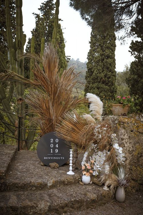 Black Wedding Sign with Dried Flower Arrangement and Orchids