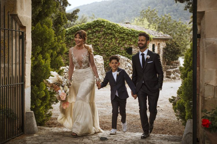 Bride, Groom and Son Entering the Drinks Reception Together