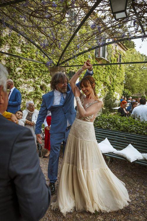 Bride Being Twirled Around by Guest