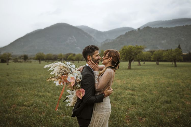 Bride and Groom Portrait with Bride Holding a Dried Flower Bouquet with Pampas Grass, Anthuriums and Orchids