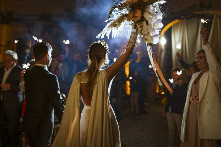 Sparkler Exit with Bride in Wedding Cape and Ponytail