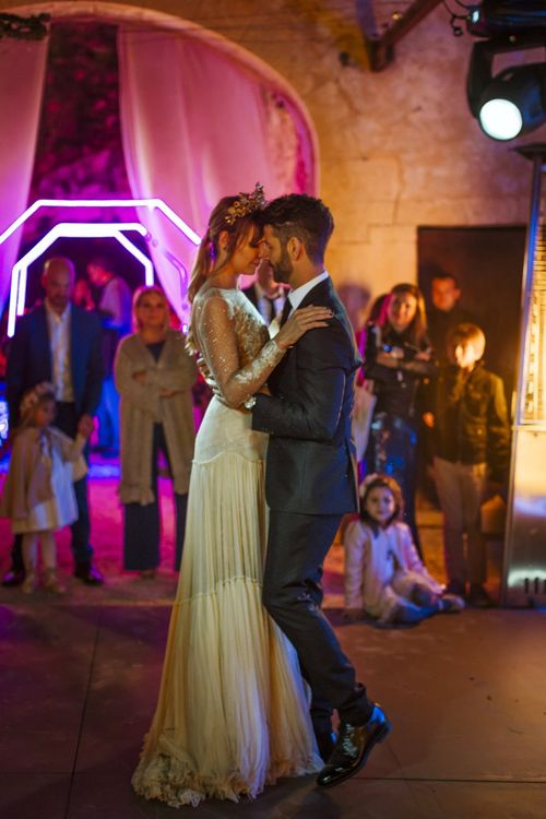 Bride and Groom First Dance with Neon Backdrop