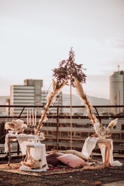 Boho rooftop wedding with naked tipi structure