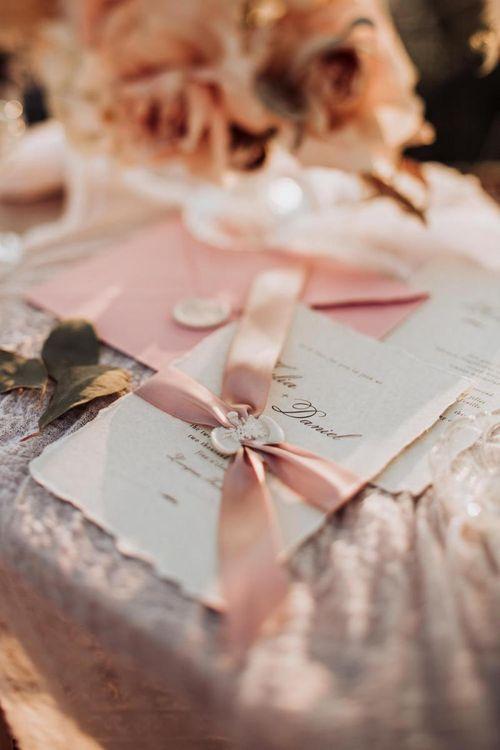Wedding invitation with punk ribbon and wax seal