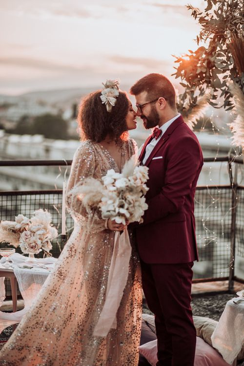 Stylish bride and groom at rooftop wedding ceremony