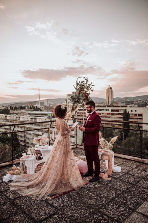 Intimate, rooftop wedding with boho styling
