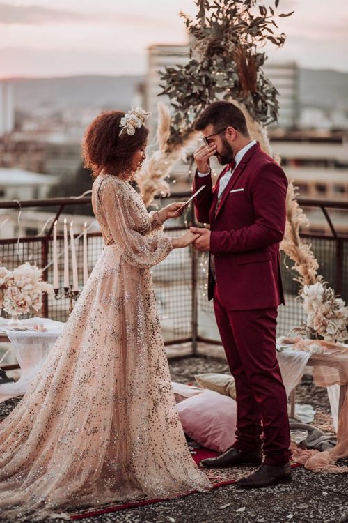 Emotional groom during intimate rooftop wedding ceremony
