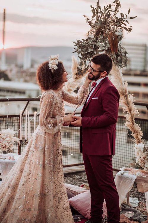 Tender wedding day moment at intimate boho wedding