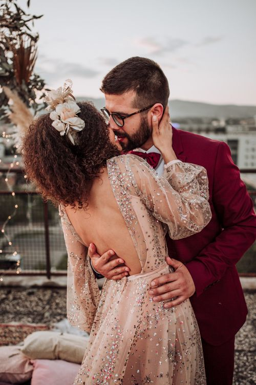 Bride in colourful sparkle wedding dress with backless detail