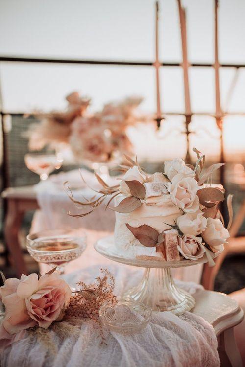 single tier wedding cake with blush roses