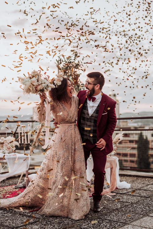 Confetti bomb moment at intimate rooftop wedding with bride in sparkle wedding dress