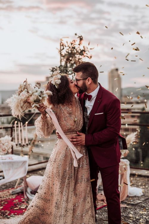 Confetti moment at intimate rooftop wedding