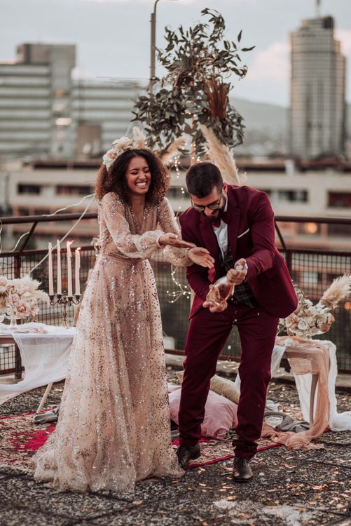Bride in tulle sparkle wedding dress with curly hair at rooftop wedding