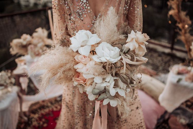 boho wedding bouquet with blush roses, orchids and pampas grass
