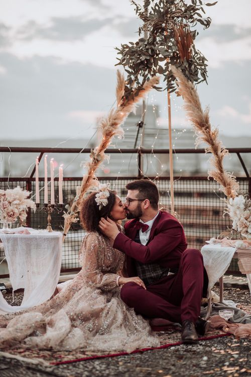 Intimate rooftop wedding with naked tipi, rugs, candles and fairy lights decor