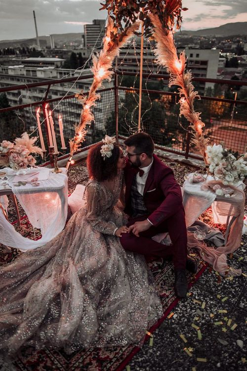 Intimate rooftop wedding with naked tipi covered in fairy lights
