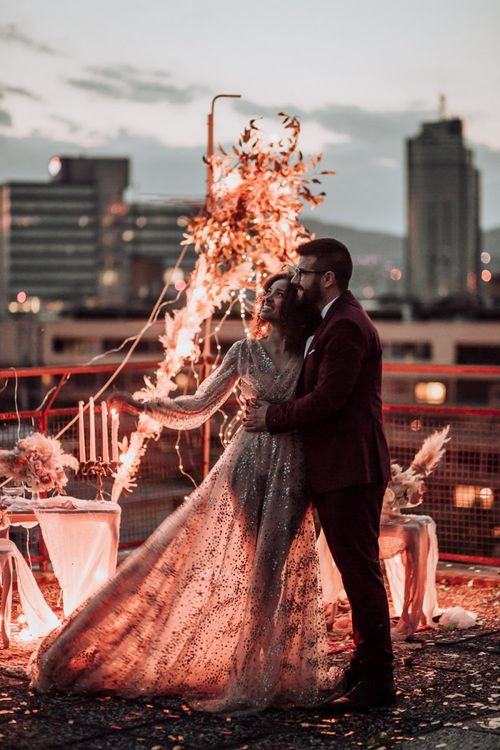 Boho bride in tulle and sparkle wedding dress at rooftop wedding reception