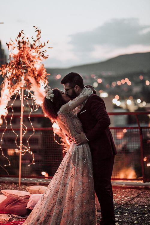 intimate rooftop wedding with bride in sparkle wedding dress glistening  under the fairy lights