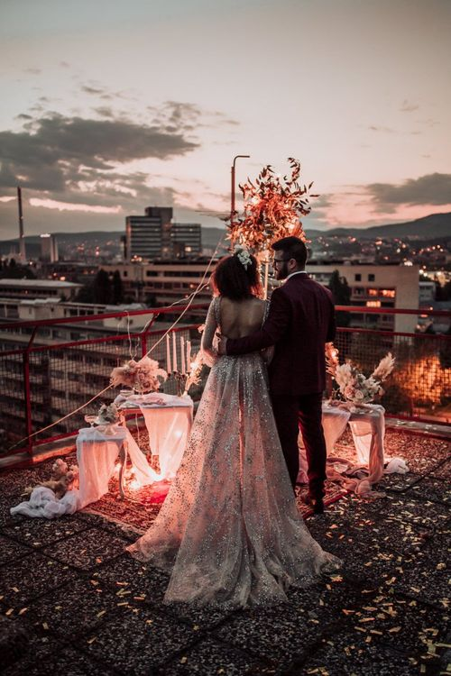 bride in tulle and sparkle wedding dress at rooftop wedding by Martina Skrobot Photography