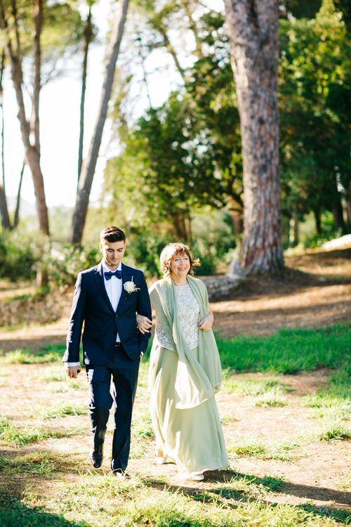 Outdoor Wedding Ceremony | Groom in Black Tie Suit | Pastel Blue & Green, Romantic, Destination Wedding at Corfu Luxury Villas, Planned by Rosmarin Weddings & Events | Mikhail Balygin Fine Art Wedding Photographer