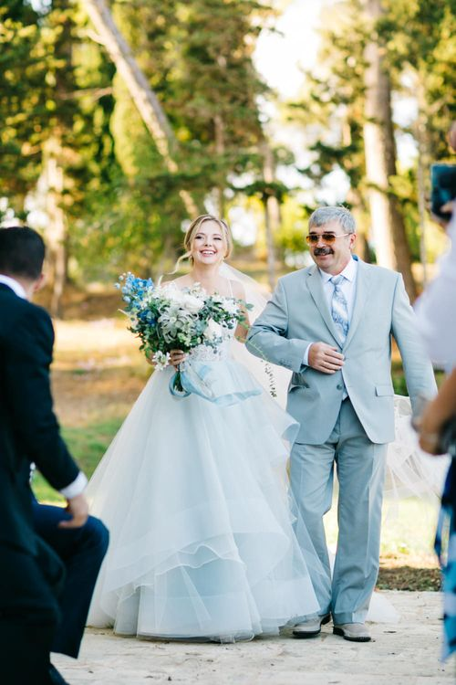 Outdoor Wedding Ceremony | Bridal Entrance in Coloured Hayley Paige Wedding Dress | Father of the Bride in Pale Blue Suit | Pastel Blue & Green, Romantic, Destination Wedding at Corfu Luxury Villas, Planned by Rosmarin Weddings & Events | Mikhail Balygin Fine Art Wedding Photographer