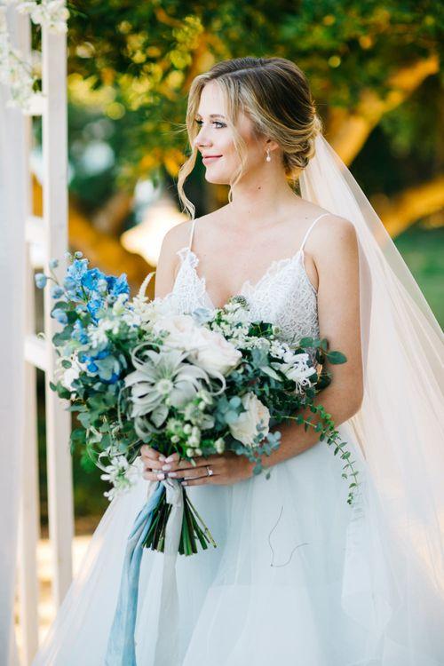 Outdoor Wedding Ceremony | Bride in Coloured Hayley Paige Wedding Dress | Oversized Bouquet | Pastel Blue & Green, Romantic, Destination Wedding at Corfu Luxury Villas, Planned by Rosmarin Weddings & Events | Mikhail Balygin Fine Art Wedding Photographer