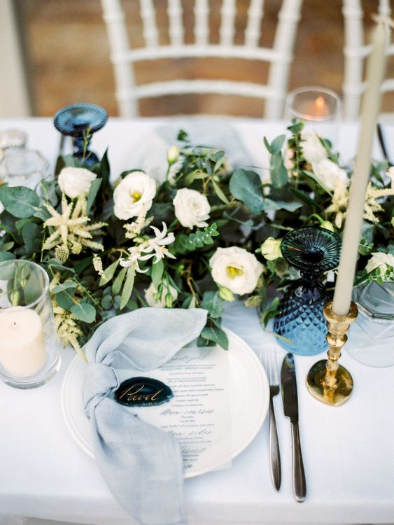 Elegant Place Setting with Coloured Goblet, Floral Table Runner, Taper Candles & Geode Name Place | Pastel Blue & Green, Romantic, Destination Wedding at Corfu Luxury Villas, Planned by Rosmarin Weddings & Events | Mikhail Balygin Fine Art Wedding Photographer