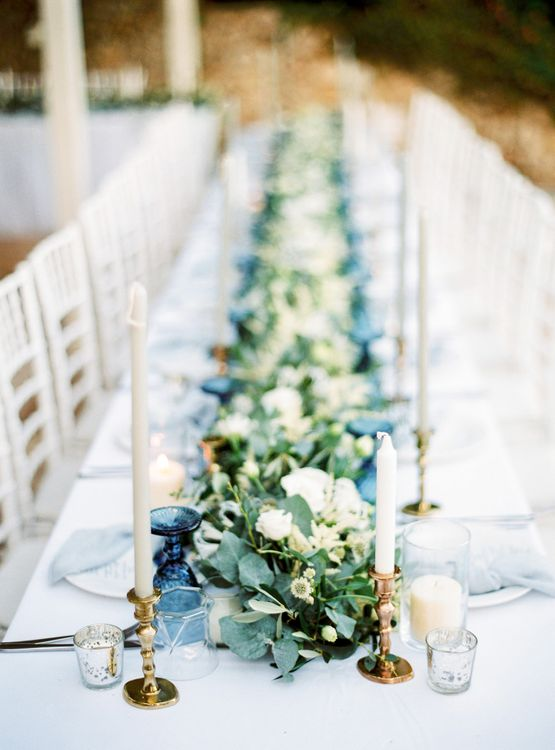 Elegant Tablescape with Coloured Goblets, Floral Table Runner, Taper Candles & Geode Name Place | Pastel Blue & Green, Romantic, Destination Wedding at Corfu Luxury Villas, Planned by Rosmarin Weddings & Events | Mikhail Balygin Fine Art Wedding Photographer
